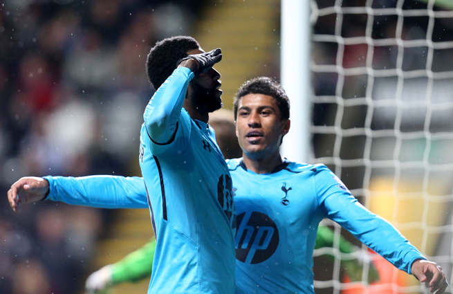 Tottenham's Emmanuel Adebayor salutes the fans after one of his two goals against Newcastle on Wednesday.