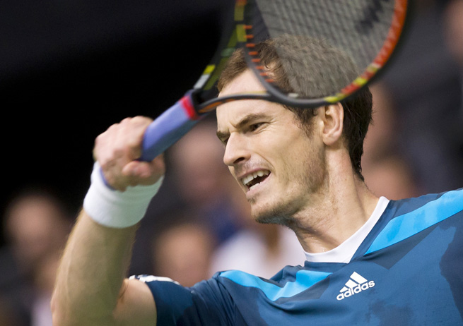 Second-seeded Andy Murray survived a tough test from Austrian qualifier Dominic Thiem.
