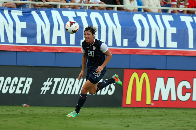 Abby Wambach added to her all-time international women's soccer goals record in an 8-0 rout of Russia on Thursday night in Atlanta.