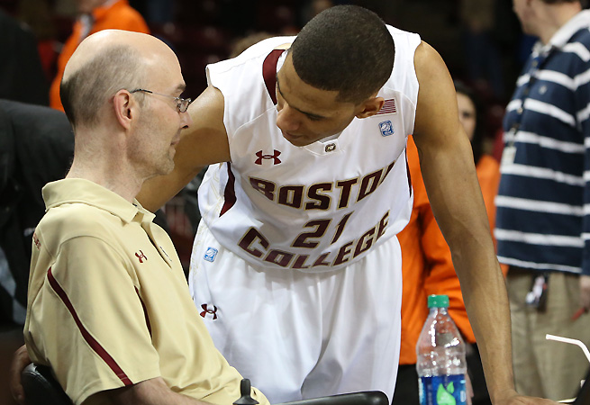 Dick Kelley, talking with BC's Olivier Hanlan last season, was a beloved figure in college basketball.
