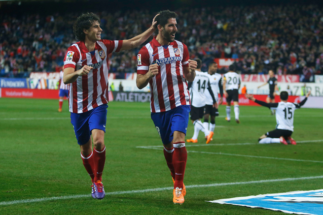 Atletico Madrid midfielder Raul Garcia, second from left, has signed an extension with the club.