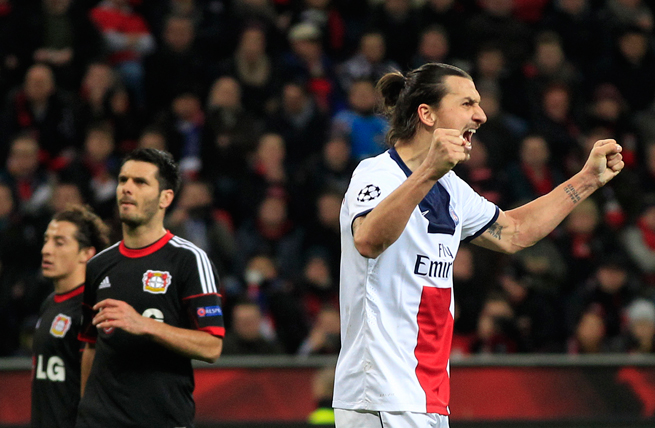 PSG star Zlatan Ibrahimovic celebrates after one of his two goals in his side's 4-0 demolition of Bayer Leverkusen in the Champions League on Tuesday.