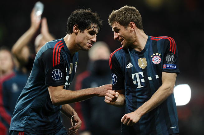 Javi Martinez, left, and Thomas Muller celebrate after Bayern Munich's 2-0 victory over Arsenal in the Champions League.