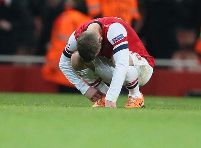 Arsenal's Jack Wilshere can only hang his head in dismay after a 2-0 Champions League loss to Bayern Munich on Wednesday.