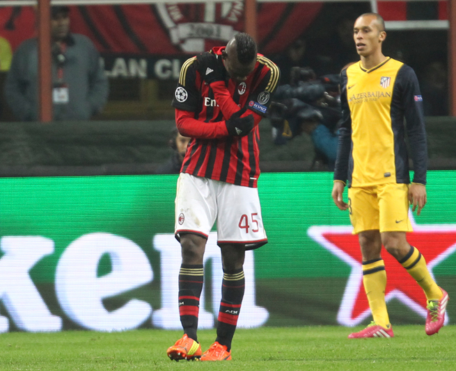 Mario Balotelli holds his ailing shoulder during AC Milan's Champions League loss to Atletico Madrid on Wednesday.