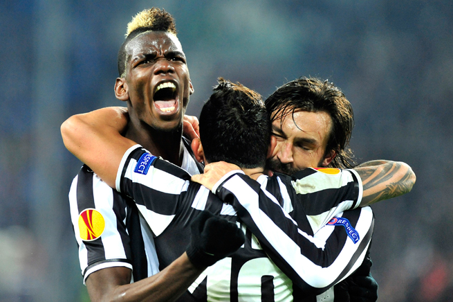 Juventus' Paul Pogba, left, celebrates his Europa League goal with Carlos Tevez, center, and Andrea Pirlo.