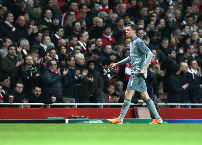 Arsenal goalkeeper Wojciech Szczesny walks off the field after being red carded against Bayern Munich on Wednesday.