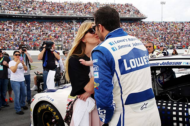 Jimmie Johnson kisses his wife, Chandra, during pre-race ceremonies.
