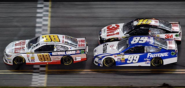 Dale Earnhardt Jr. leads Carl Edwards and Greg Biffle during a Daytona 500 that was suspended for six hours by rain.