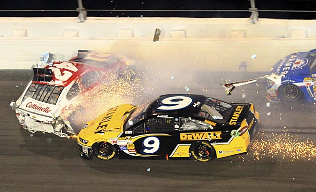 Kyle Larson (42) and Marcos Ambrose (9) crash.