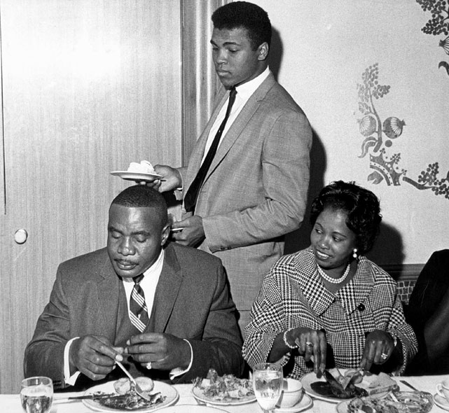 On Nov. 5, 1963, Liston finally signed to defend his title against the upstart Clay. At the press gathering to announce the bout, the challenger, his slice of pie (figuratively and literally) finally in hand, kept a wary eye on the champion as Mrs. Liston appeared to be awaiting some new development in the horseplay that highlighted wild press conference.