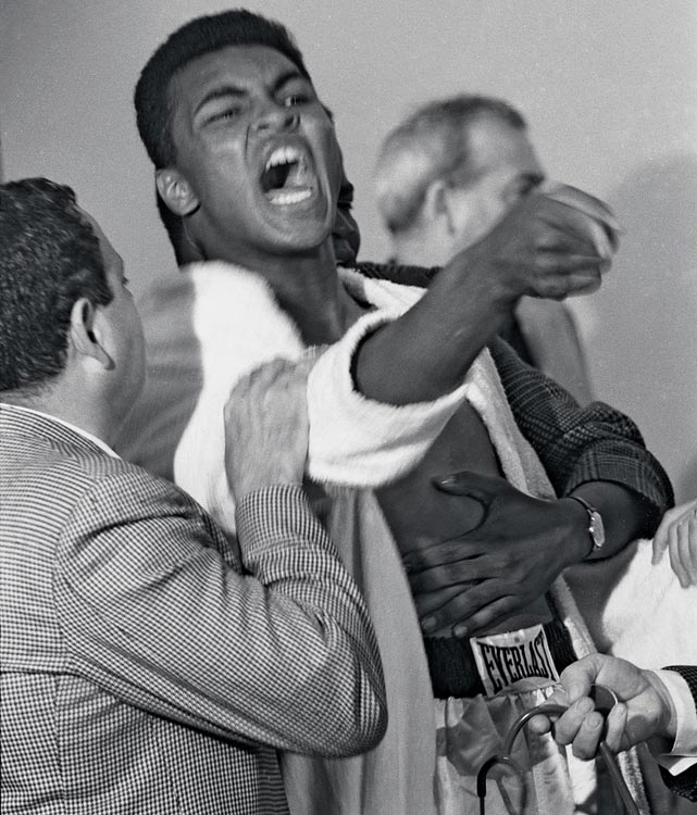 Ali, here being restrained by his trainer, Angelo Dundee, was fined $2,500 for his outburst. For the challenger, the effect would be more than worth it.