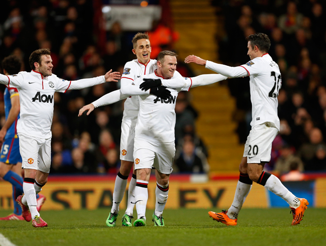 Wayne Rooney, center, scored in his first game after pledging his future to Manchester United with a new long-term contract.