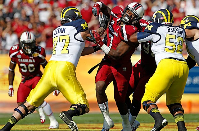 Clowney is double-teamed as he rushes against Michigan in the Outback Bowl.