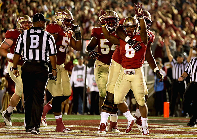 Devonta Freeman (8) and Florida State brought the BCS title to the ACC with a 34-31 win over Auburn.