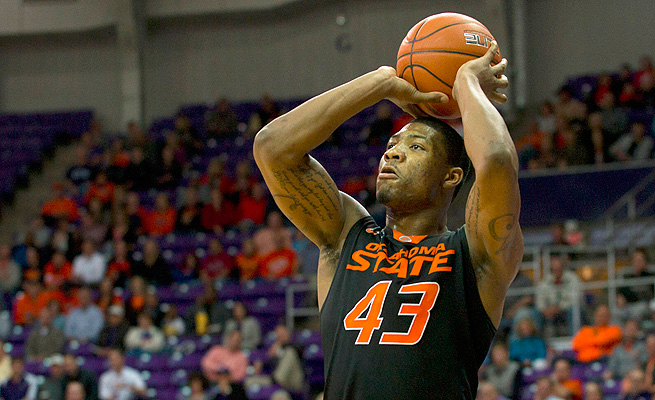 Marcus Smart has lived under scrutiny this year at Oklahoma State, but would it have been worse for him in the NBA?