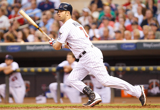 Joe Mauer will be moved permanently to first base, but he maintains catcher eligibility for the season.