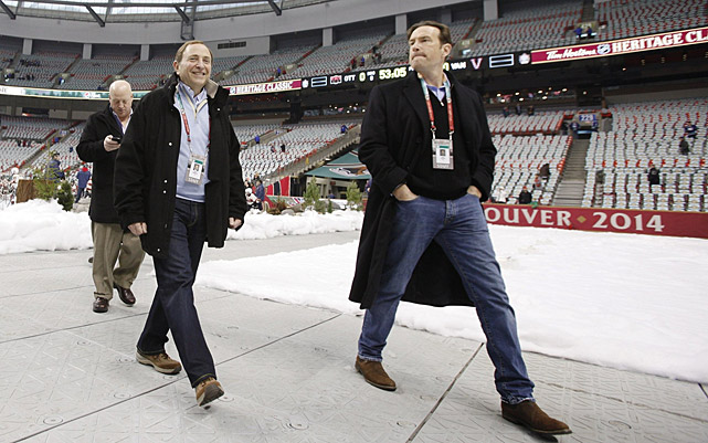 """Commissioner Gary Bettman (center) and league COO John Collins may have pressed the league's luck by scheduling so many outdoor games in one year. Tickets were still available the day of the Heritage Classic and fake snow was used to create the proper atmopshere. There were also some complaints about the ice. """"I was glad (organizers) had the option to close [the roof