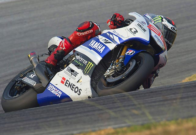Spanish motorcyclist Jorge Lorenzo rounds a band at the Sepang Circuit in Malaysia.