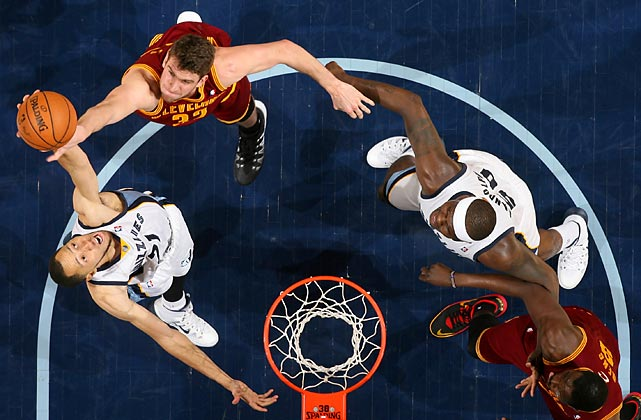 Tayshaun Prince of the Memphis Grizzlies comes up with a rebound over Cleveland Cavaliers center Spencer Hawes during a Saturday contest in Memphis. The Grizzlies won 110-96.