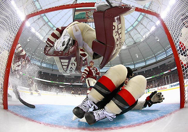 Clarke MacArthur of the Ottawa Senators slides into Vancouver Canucks goaltender Eddie Lack during the 2014 NHL Heritage Classic in Vancouver. The Senators won 4-2 behind a goal and an assist from MacArthur.