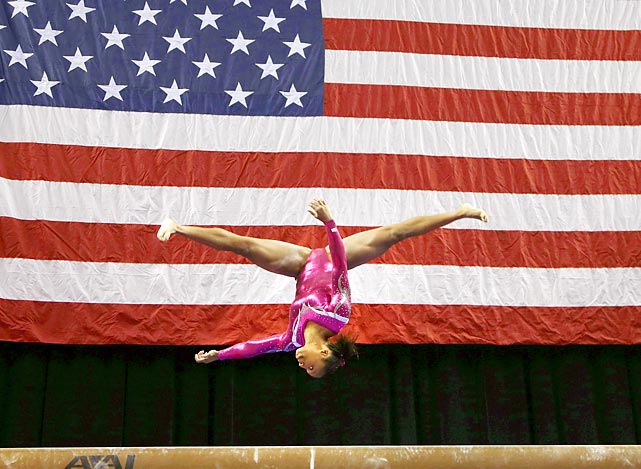 Elizabeth Price performs her routine on the beam during the American Cup competition in Greensboro, N.C. Price, 17, claimed the women's overall title.