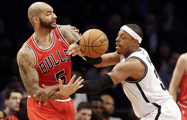 Carlos Boozer and the Bulls were held to 80 points in a loss to the surging Nets and Paul Pierce.