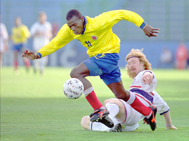 Faustino Asprilla attempts to get by former U.S. defender Alexi Lalas in the 1995 Copa America third-place game. The two also did battle in the 1994 World Cup in the USA.