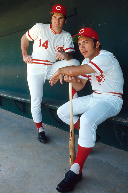 Pete Rose and Johnny Bench pose in the dugout during spring training in Tampa, Fla.