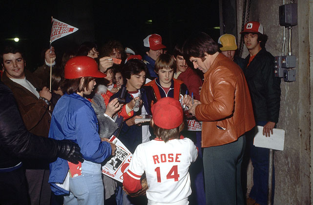 Rose fans clamor for his autograph.
