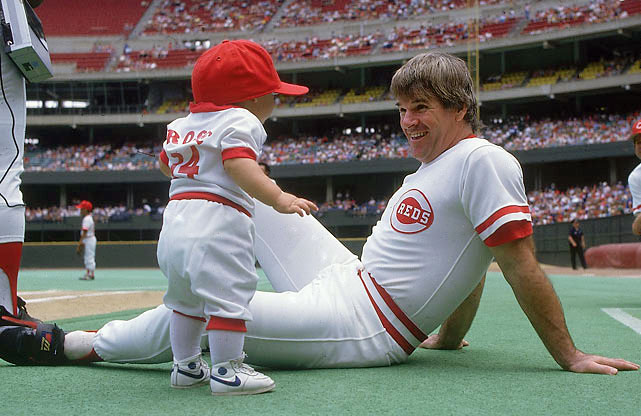 Rose plays around with his one-year-old son, Tyler, before a game. By 1985, Rose had divorced his first wife (Kaarolyn Englehardt) and married Carol J. Woliung. The pair had Tyler shortly after their marriage.