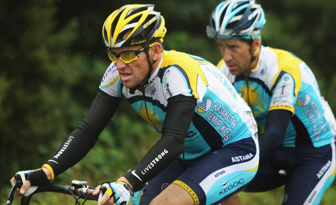 Lance Armstrong will be forced to give new testimony regarding his doping due to reopened settlement.