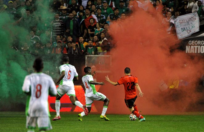 Mexico and Nigeria briefly had to play with smoke bombs on the field in a scoreless draw in Atlanta.