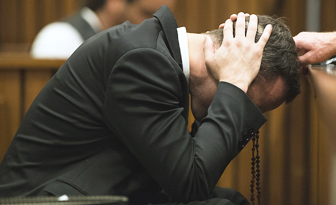 Oscar Pistorius covered his ears as a witness described the events after Pistorius shot his girlfriend.