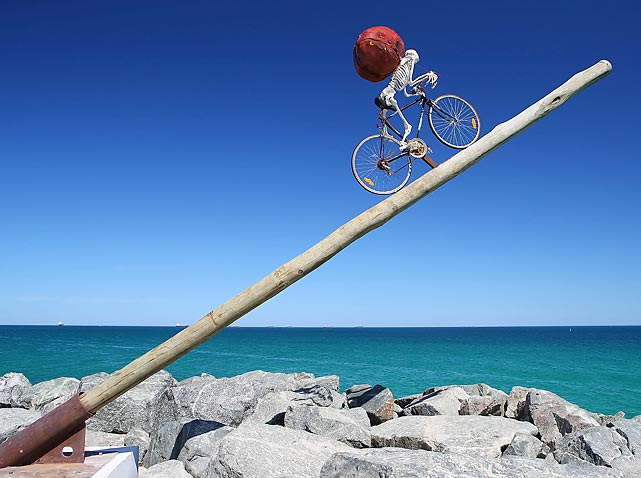 Assembled by a skeleton crew, this bare bones tribute to cycling by artist Ken Unsworth graced the 10th annual artistic clambake at Cottesloe Beach in Perth, Australia. Perhaps this is what inspired his work.
