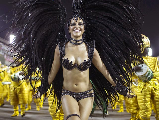 Just to keep you abreast of developments in Rio de Janiero, here's Drum Queen Mariana Rios of the Mocidade samba school gracing the annual celebration. Alas, another Carnival did not fare as well...(Please proceed to next slide. Thank you.)