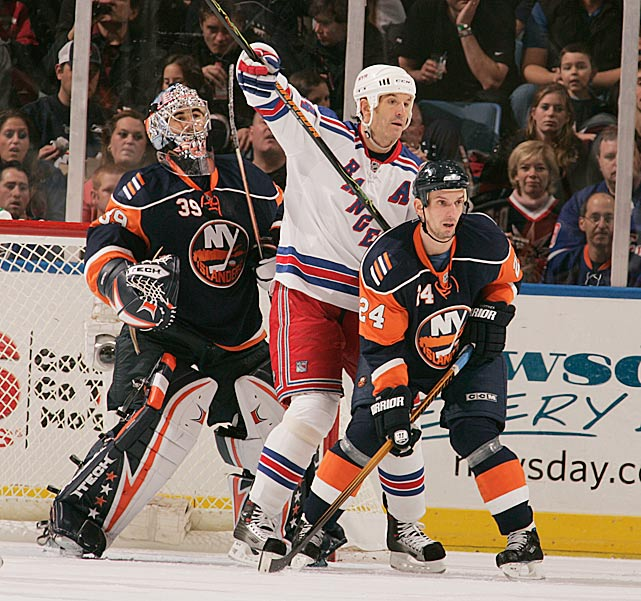 Shanahan (left, in white) signed as a free agent at age 37 in July 2006. The rugged eight-time All-Star scored 29 goals (second most on the team) during the first of his two seasons with the Rangers, both of which ended with New York bowing out of the playoffs in the second round. Nevertheless, Shanahan's play on Broadway was significant: He became the 15th NHL player to reach 600 goals; joined Gordie Howe as the only players in the history of the league to score 25 or more goals in 18 consecutive seasons; and won the Mark Messier leadership award. But his wish for one last Stanley Cup (he won three with the Red Wings) went unfulfilled, and he retired in '09 after a farewell season with the Devils -- with whom he began his NHL career in 1987. Shanahan was inducted into the Hall of Fame in 2013. <bold>Notable Rangers during Shanahan's tenure:</bold> Jaromir Jagr, Henrik Lundqvist, Chris Drury