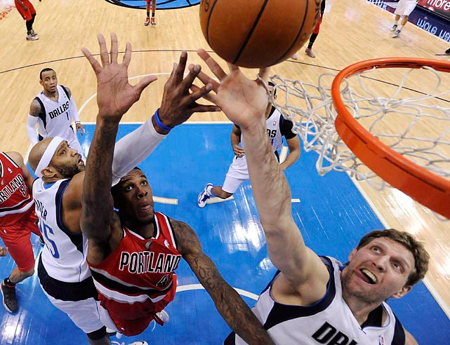 Dirk Nowitzki of the Dallas Mavericks reaches for the ball during a Friday contest against the Portland Trail Blazers. The Mavs claimed a 103-98 victory behind 22 points from Nowitzki.
