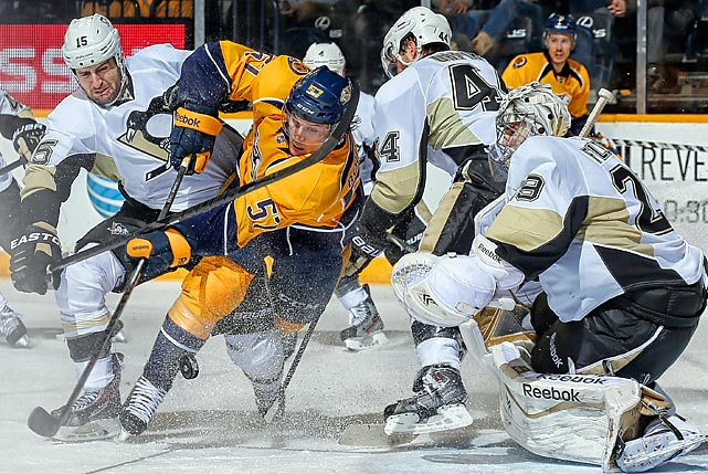 Gabriel Bourque of the Nashville Predators slices toward the net as Pittsburgh Penguins goaltender Marc-Andre Fleury watches in a Tuesday NHL game. The Penguins won 3-1.