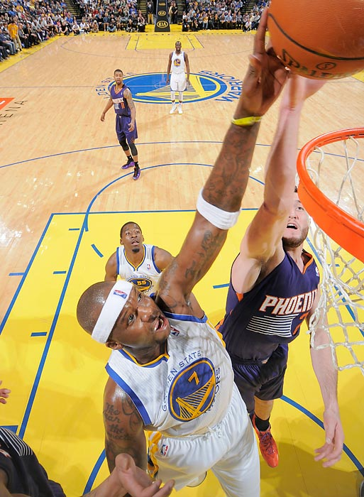 Jermaine O'Neal of the Warriors and Alex Len of the Suns go up for the ball in a Sunday game. The Warriors won 113-107.