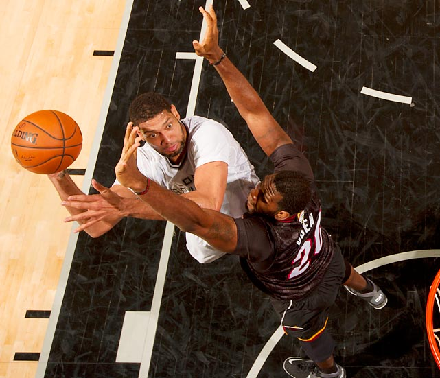 San Antonio Spurs forward Tim Duncan looks to shoot over Miami Heat center Greg Oden during a rematch of the 2013 NBA Finals. Duncan scored 23 points and grabbed 11 rebounds in a dominant 111-87 San Antonio victory.