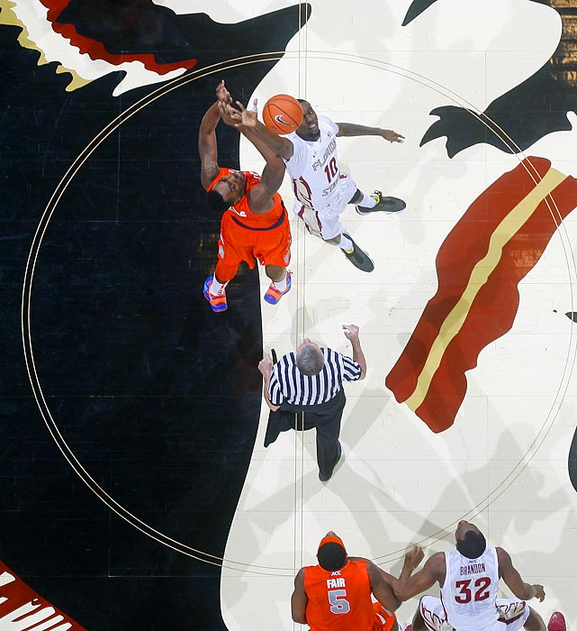 Rakeem Christmas of Syracuse and Okaro White of Florida State reach for the tipoff during a Sunday game in Tallahassee. The Orange topped the Seminoles 74-58.