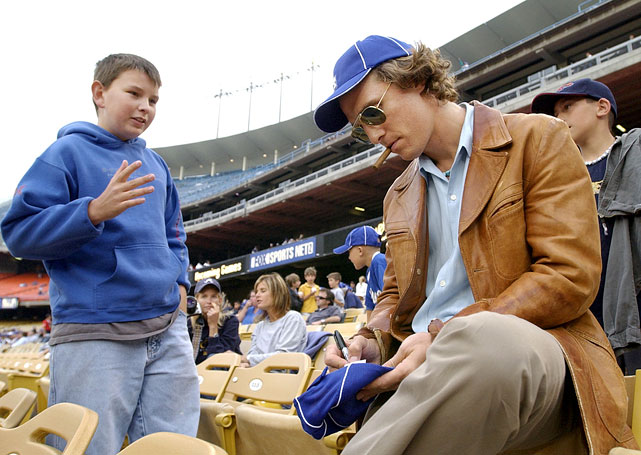 Matthew McConaughey autographs a Los Angeles Dodgers cap for a fan prior to the Dodgers game against the Atlanta Braves on May 13, 2003 at Dodger Stadium.