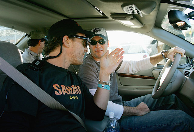 Matthew McConaughey and Jimmie Johnson talk things over before their drive around Daytona International Speedway one day prior to the Daytona 500 on Feb. 19, 2005 in Daytona, Fla.