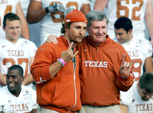 Matthew McConaughey poses with University of Texas head coach Matt Brown during a team photo at the Rose Bowl on Jan. 3, 2006 in Pasadena, Calif.