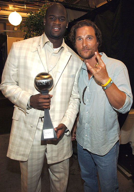 Vince Young and Matthew McConaughey pose backstage after Young received the ESPY award for Best Championship Performance on July 12, 2006 at the Kodak Theatre in Los Angeles.