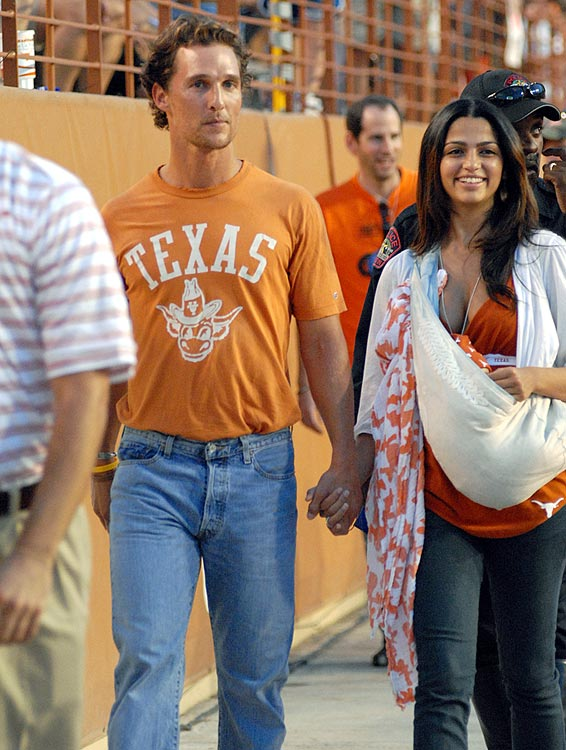 Matthew McConaughey and Camila Alves roam the sidelines during the Texas Longhorns' 52-10 win over Florida Atlantic University on Aug 30, 2008 at Royal Texas Memorial Stadium in Austin, Texas.
