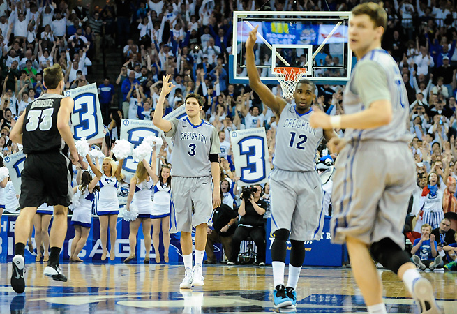 Doug McDermott celebrates his 3,000th point on senior night.
