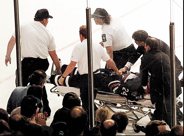 During Game 2 of his team's first-round playoff series vs. Dallas in April 1997, the Edmonton Oilers defensemen tripped and fell head-first into the penalty box door just as Stars forward Guy Carbonneau opened it to return to the ice. Marchment's helmet came off and he was severely concussed by the impact. The crowd and 1.5 million viewers on <italics>Hockey Night in Canada</italics> watched in horror as he convulsed on the ice. He regained consciousness while being rushed to a local hospital where an MRI and CAT scan found that he had sustained no brain damage. However, when he tried to play in the opening game of Edmonton's next series, he felt too dizzy to continue. He then took the summer off to fully recover.
