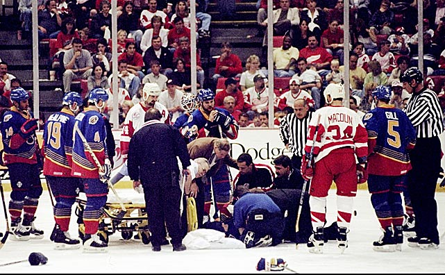 "During a playoff game in May 1998, the St. Louis Blues defenseman was hit in the chest by a slapshot by Detroit's Dmitri Mironov. The impact disrupted his heart's rhythm and after taking two strides, Pronger's eyes rolled back into his head and he collapsed to the ice. Blues team trainer Ray Barile later reported that Pronger, whose heart had stopped briefly, was unconscious for 20 to 30 seconds as medical personnel attended to him. He was stretchered off to a hospital where tests revealed that his heartbeat had returned to normal. ""At the end he was talking to me,"" Blues winger Geoff Courtnall told the <italics>Los Angeles Times</italics>. ""He was asking me what happened and asking how much time was left in the game. [Rich Peverley asked the same question upon being revived in Dallas.] Emotionally, he was pretty scared. It would scare anybody."""